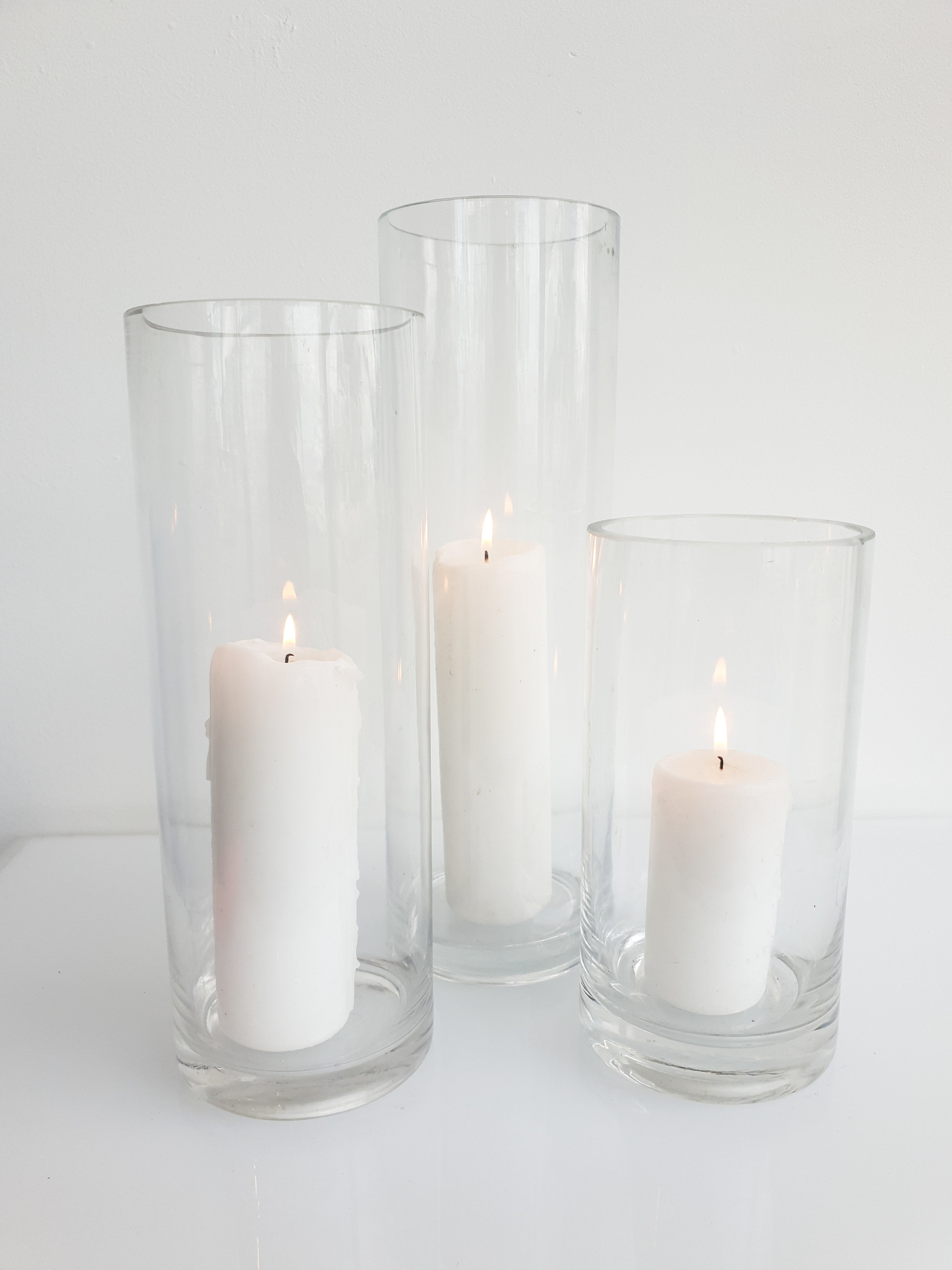 GLASS CYLINDER VASE WITH PILLAR CANDLE 20 CM H $10+GST 25 CM H $10+GST 30 CM H $12+GST 40 CM H $14+GST