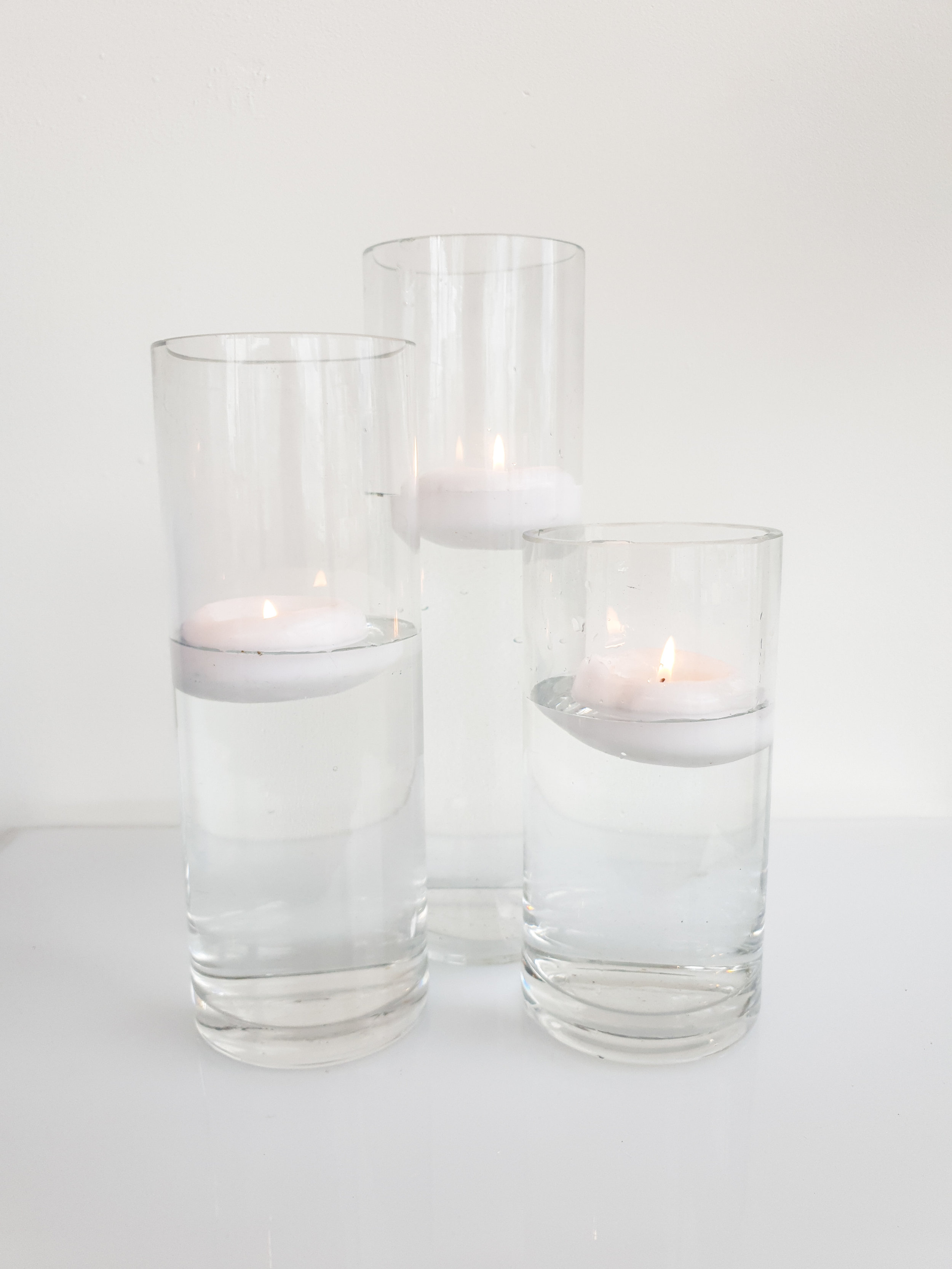 GLASS CYLINDER VASE WITH FLOATING CANDLE 20 CM H $8+GST 25 CM H $8+GST 30 CM H $10+GST 40 CM H $12+GST