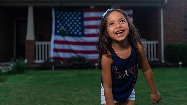 """Just 2 days ago, Scarlett started kindergarten! I wanted to share this photo from July 4th. We are so excited to watch her grow up to the little amazing person that she is. She blows my mind every day with everything she learns and absorbs. This girl is a machine!  On that note, 18 years ago, 9/11 happened. I want to give a shout out to all the troops, first responders, volunteers, the unseen and unspoken soldiers, and their families who clock in every single day and stand on the front lines of danger and unrest. These are people who leave their families, sometimes for long periods of time, to ensure the american dream. They risk it all, so that we can live in a safer world. In a world where we can ride our motorcycles, shoot off fireworks, send our kids to school on buses with no fears of kidnappings or corruption. We live a life where the unseen and unspoken can easily be taken for granted. Having visited other countries, these daily tasks are things we don't even see. The fact I can buy a gallon of milk for $1.17, in a store that is fully stocked and anything I can dream of can become a reality in this country carries a toll. Terrorist attacks do not occur in the U.S. as frequently and openly as they do in other parts of the world. The next time I see a service member or their supporter, know that the handshake and phrase """"thank you for your service"""" carries a tremendous weight.  Thank you, for everything you do. Thank you for keeping Scarlett and our family, safe, happy, and healthy. God bless you, and these United States of America ----- #usa #freedom #911 #thankyou #military #police #neverforget #raleigh #nc #twintowers"""