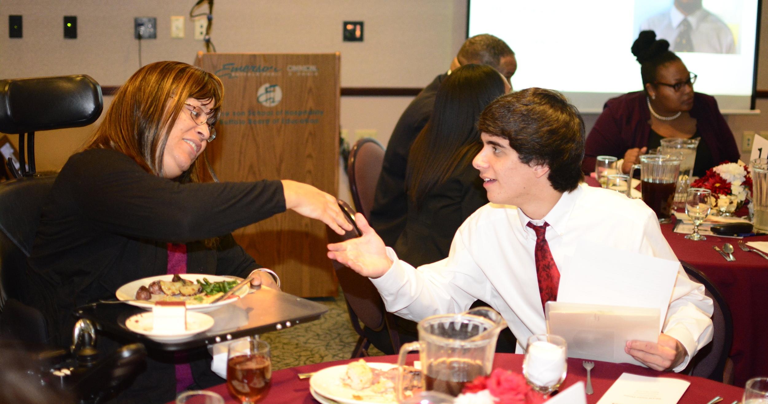 dinner shaking hands.JPG