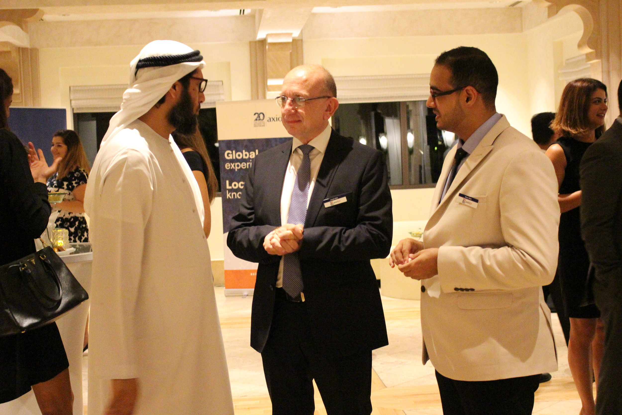 Dr. Joseph Saba and Dubai-based Program Assistant Adnan Elkot speaks with Salim bin Lahej, Dubai Health Authority's Director of Community and Humanitarian Services