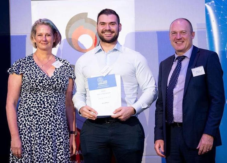 Anna Wright and Mladen Jovanovic receive the Merit Awards at the AIIA Awards.