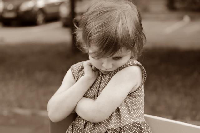 sad toddler.sepia.jpeg