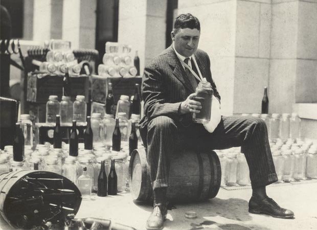 Jesse James Bailey, who was sheriff of Madison County from 1920 to 1922, inspecting confiscated moonshine. Photo courtesy of the Southern Historical Collection, Wilson Library, University of North Carolina at Chapel Hill.
