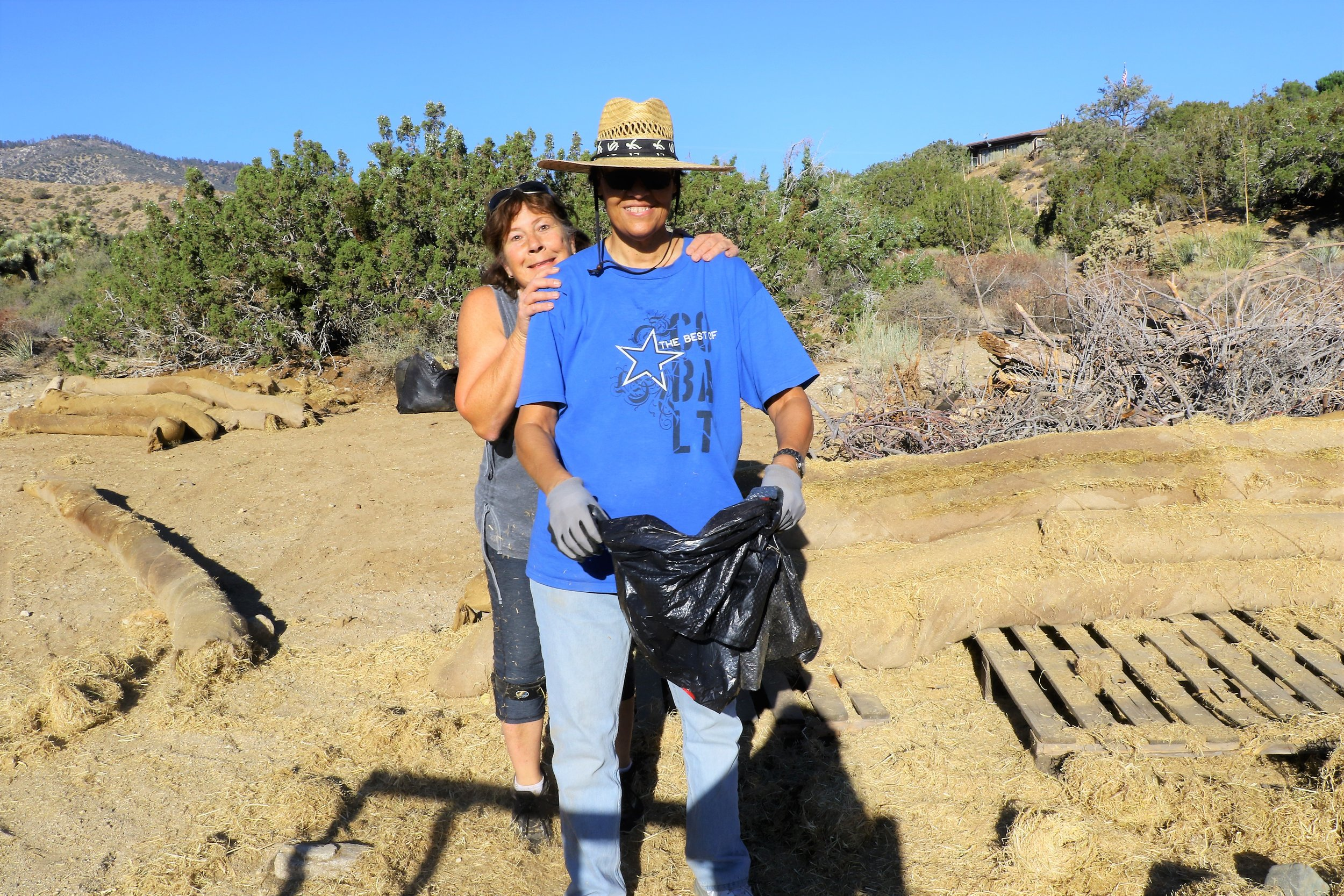 August 2018 Sue Harris and Angie Prudhomme taking a break from salvaging erosion wattles for use in Portal Ridge and Puma canyon project areas.