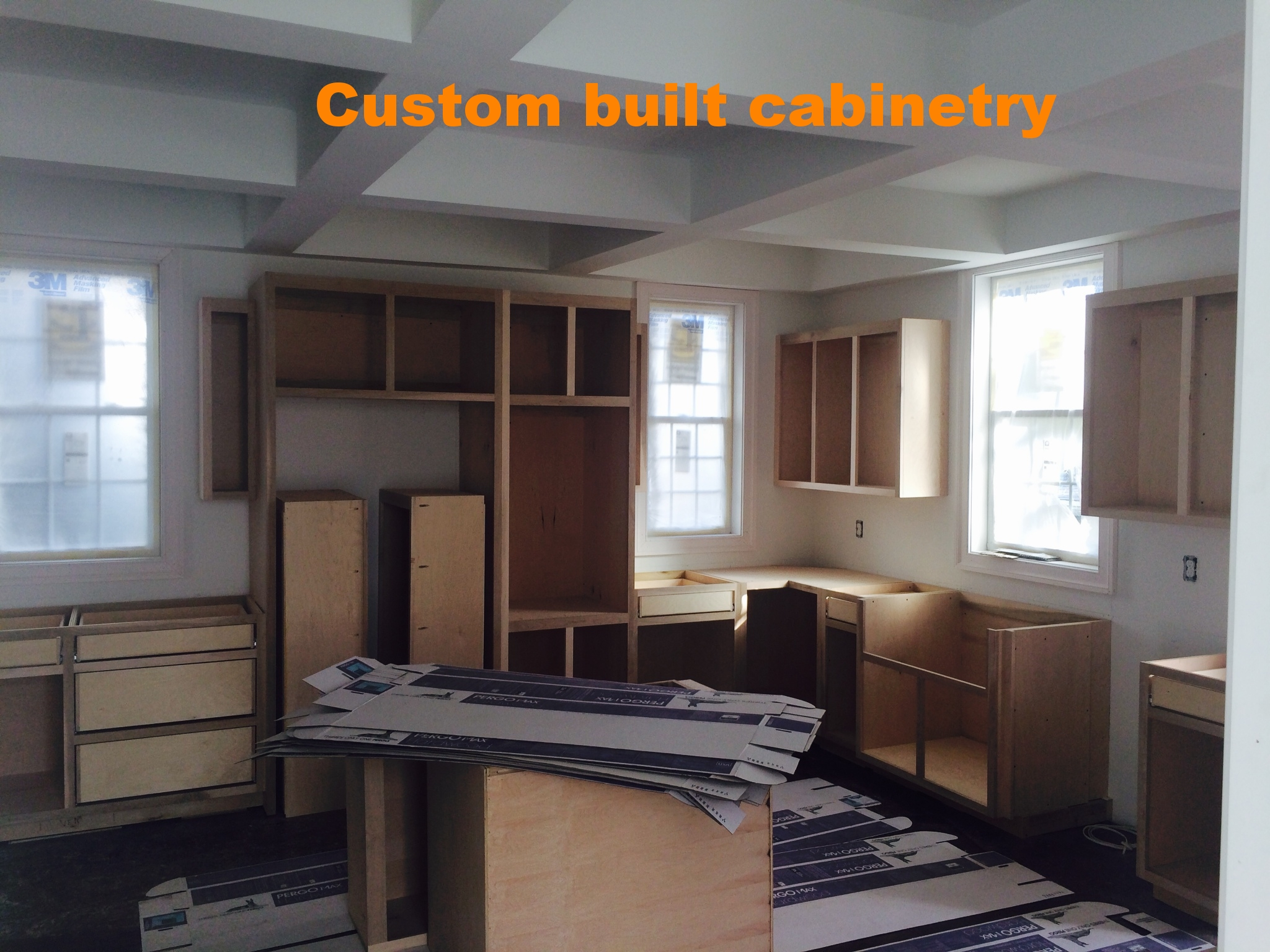 custom kitchen cabinets going in.JPG
