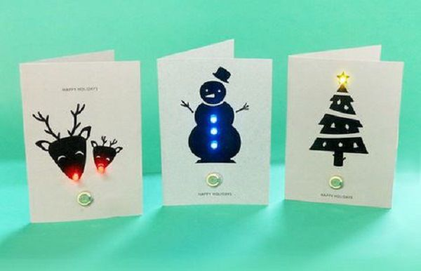 CARTÃO ILUMINADO: Nesta oficina os alunos usam LEDs para criar um cartão iluminado. Eles criam os desenhos e aprendem a usar baterias para acender partes do desenho. Eles  levam o cartão para casa  ao final.