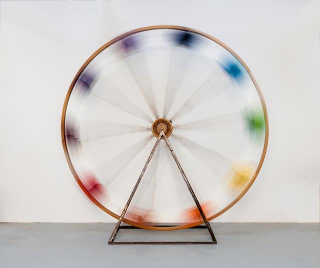 The Rainbow Wheel , 2012 laminated wood, found objects, flocked aluminum, iron 12 x 12 feet
