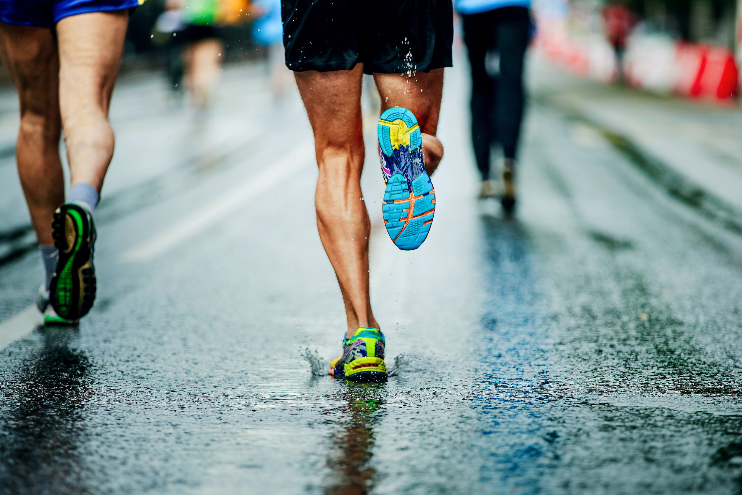 running in rain on pavement.jpeg