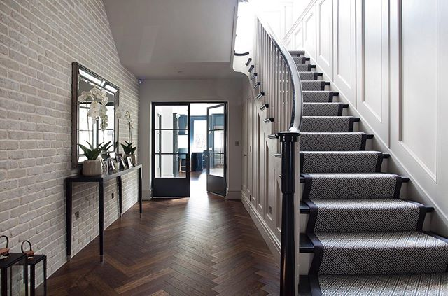 An entrance hall we recently completed- bespoke panelling and details with beautiful timber floors and stairs runner. In collaboration with @brazilassociates