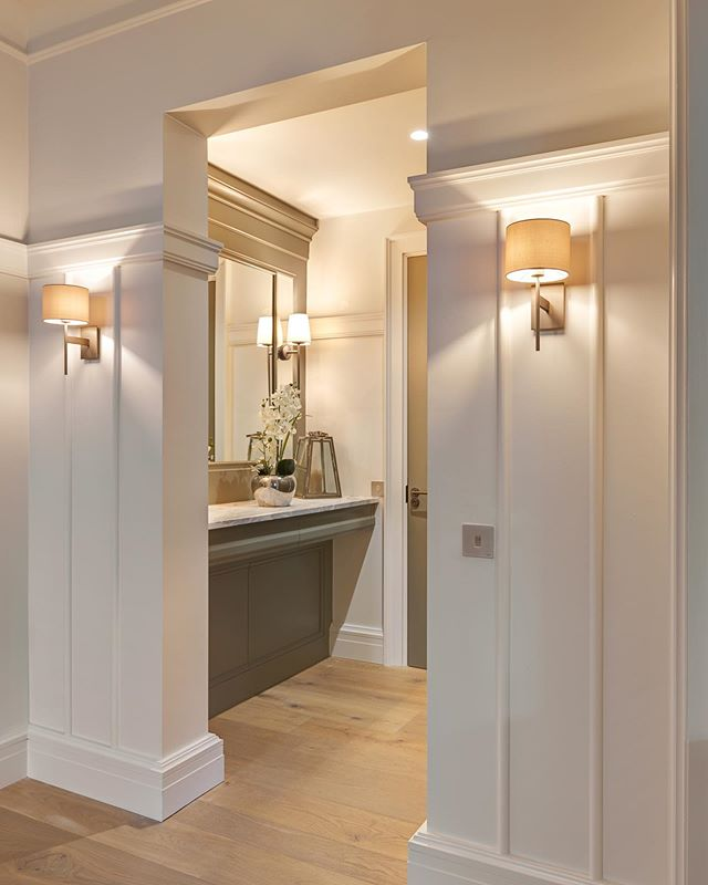 Beautiful panelled hall alcove with inset mirror and stone top below.
