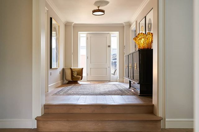 A wonderful entrance hall completed with unique furniture pieces, feature light and timber flooring. In collaboration with @brazilassociates