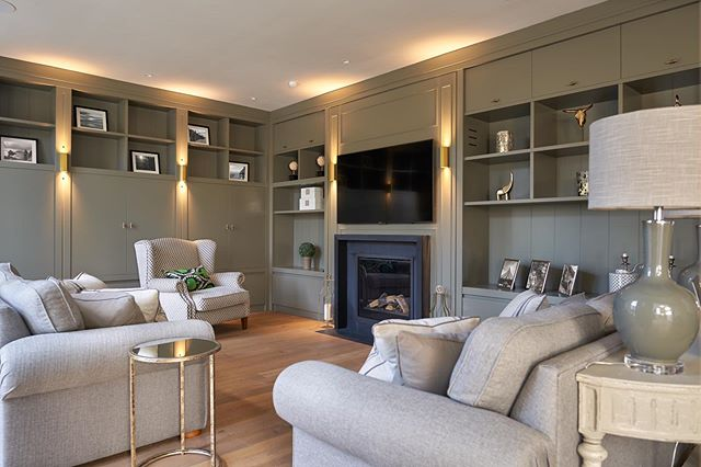 Bespoke cabinetry design and fire surround, with wide board oiled timber floors for a family tv room. Architecture @brazilassociates, Soft furnishings @helenturkingtondesign