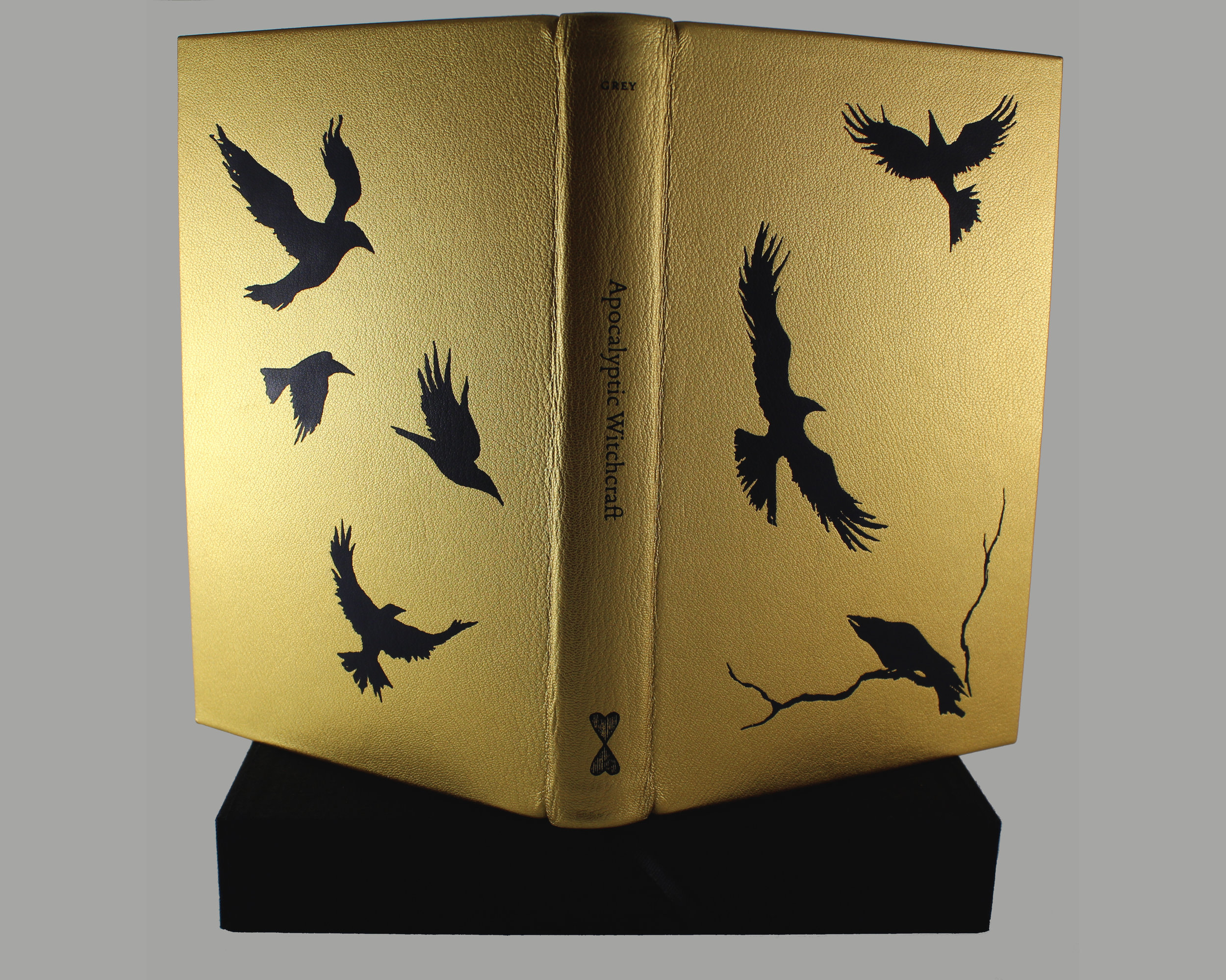 Fine edition bound in full gold hand-grained morocco stamped with a murder of crows