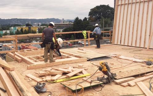 Fieldworkers on Sunshine Portland rooftop