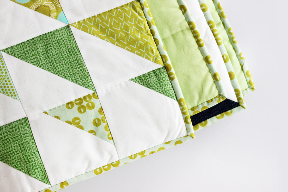 Chic patterns, elegant gold accents and cool hues make Zen Chic's Day in Paris fabric line a perfect match for Purl Soho's Prism quilt free pattern.