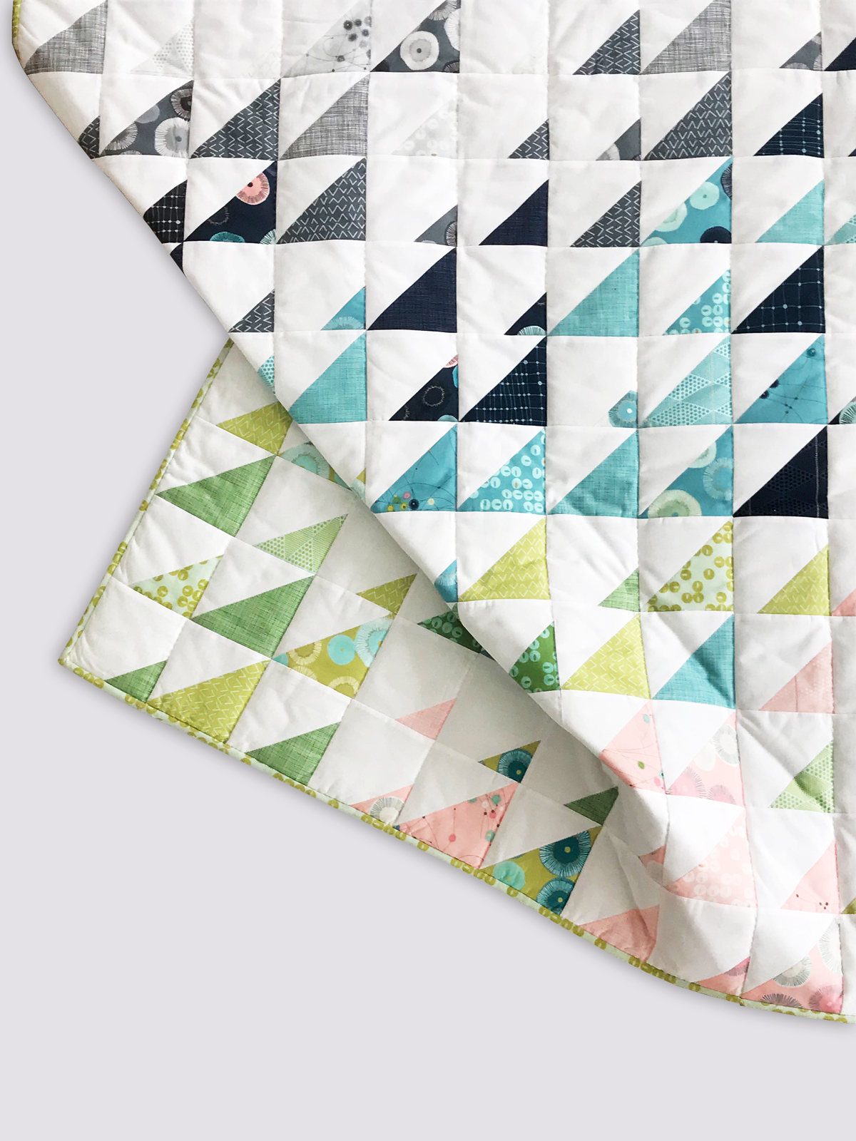 Sew this stylish, inviting quilt using Zen Chic's Day in Paris Fabric line with Purl Soho's Prism quilt free pattern.