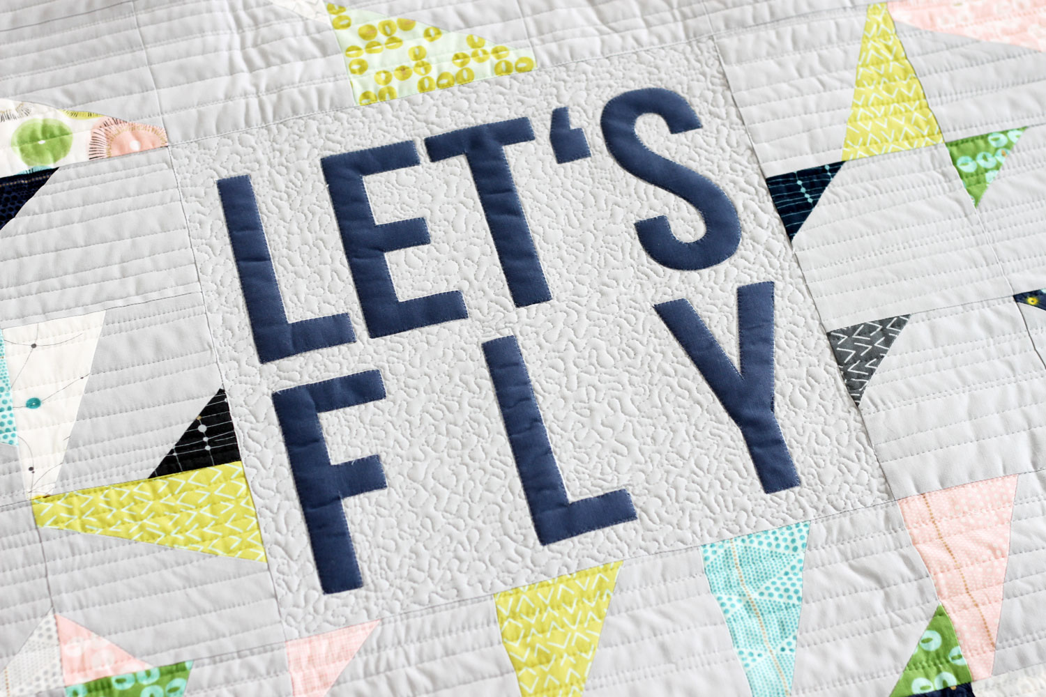 Let's Fly, improvisational modern quilt pattern by Zen Chic, using Charm Packs from the collection Day in Paris by Zen Chic for Moda