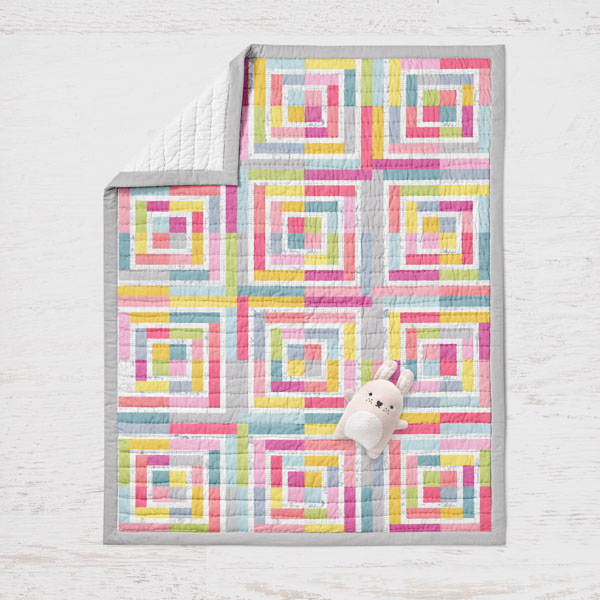 This sweet crib-size baby quilt can be easily created by a beginner using the Basic Series Log Cabin Fun pattern from Zen Chic