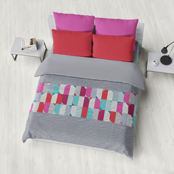 This large bed-size quilt created with the Just Flip It pattern from Zen Chic offers a dynamic, fun addition to any bedroom.
