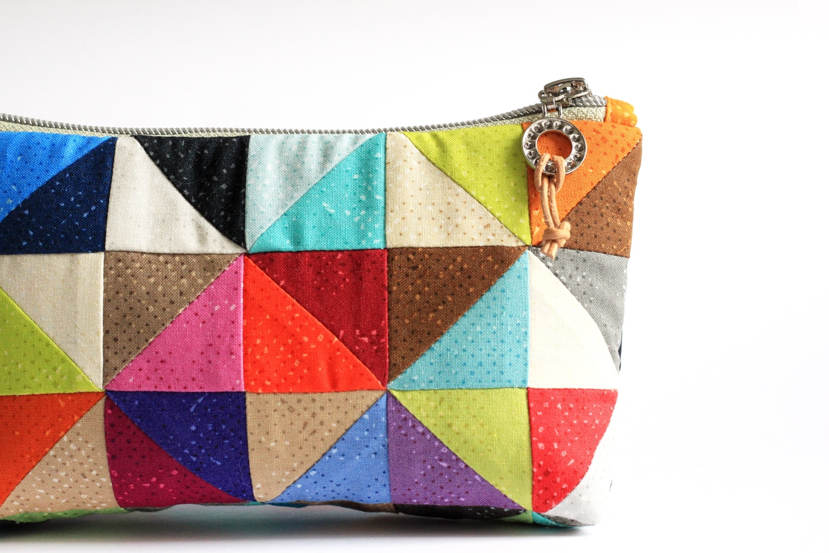 This fun zippered pouch is an excellent way to show off the new color additions to Zen Chic's Spotted fabric line.