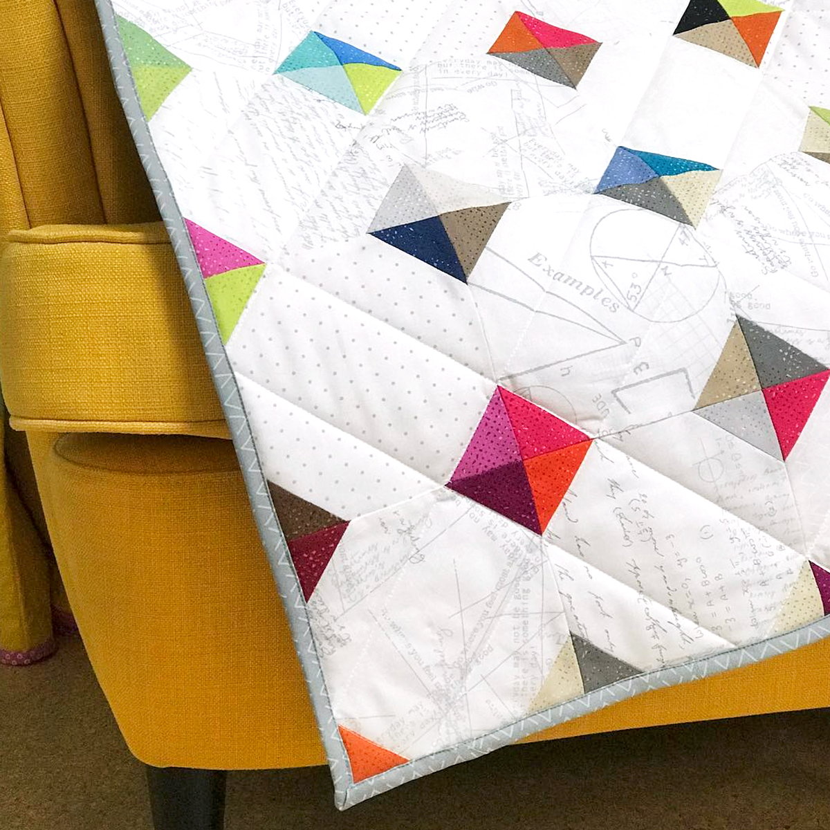 Engaging textures and dynamic colors make Zen Chic's Spotted New Colors fabric line the ideal match for Purl Soho's Tiny Tiles free quilt pattern.