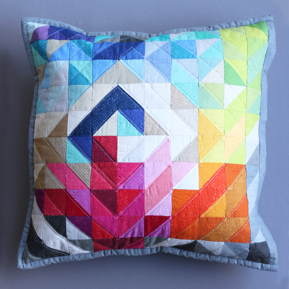 A couple of Mini Charm Packs of Spotted New Colors by Zen Chic inspired this unique half-square triangle pillow.