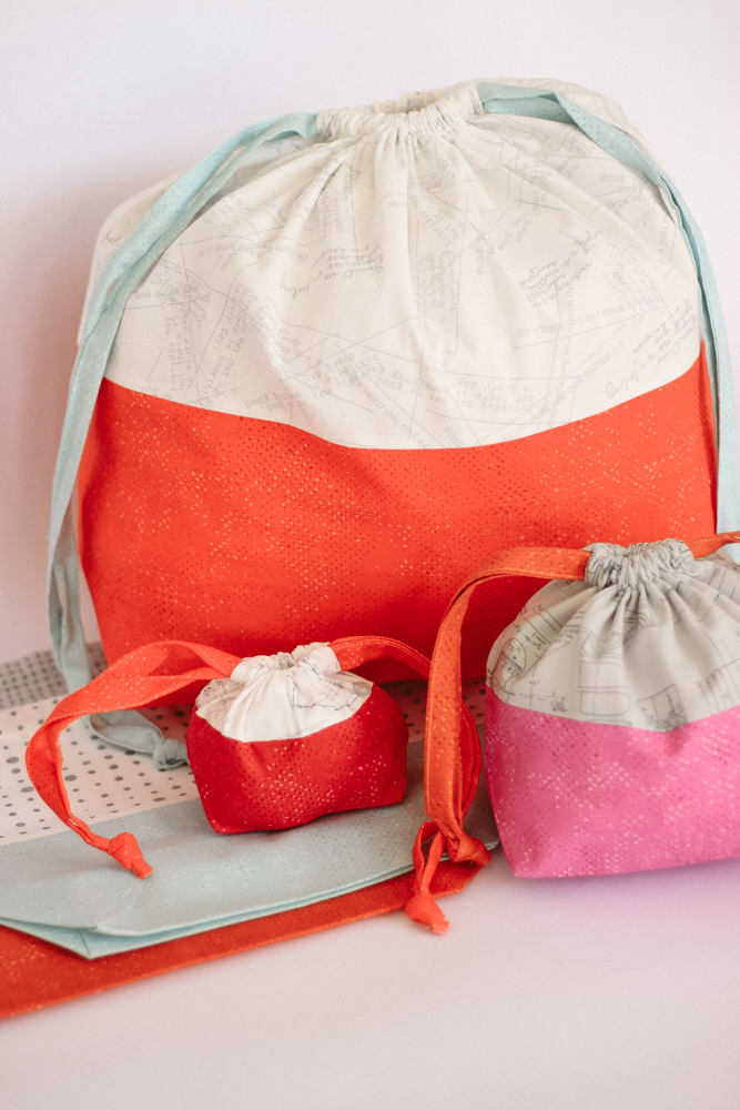 Zen Chic's Spotted New Colors along with More Paper fabric collections are perfect for Purl Soho's free drawstring bags pattern.