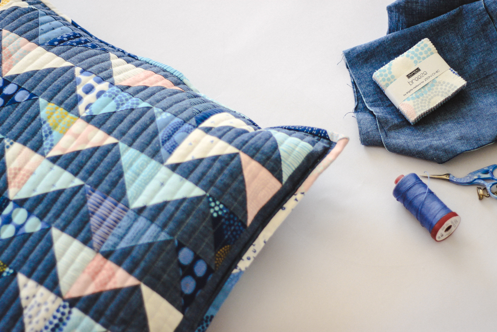 A mini charm pack of Zen Chic's Breeze fabric collection, a bit of background fabric and simple instructions are all it takes to create this gorgeous flying geese pillow.