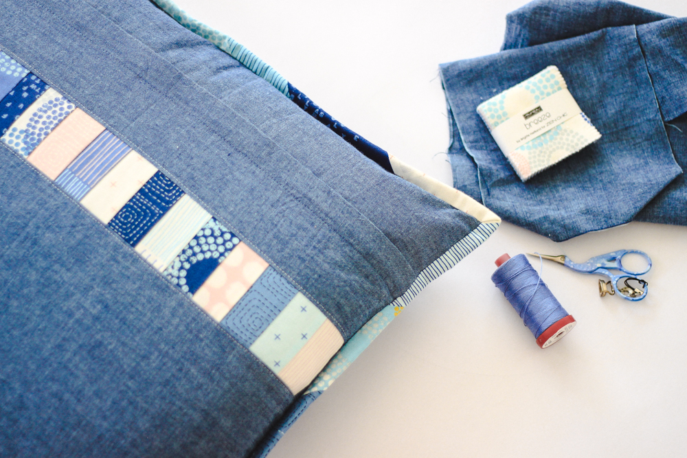 A charming accent pillow made with a mini charm pack of Zen Chic's Breeze fabric collection.