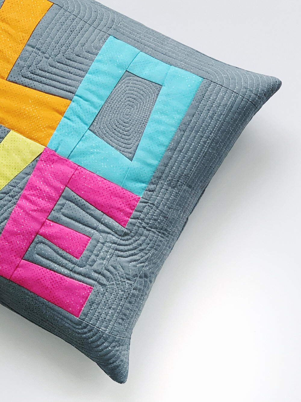 """12"""" block size… - Let's take a look at the larger version of this block with this 16"""" x 16"""" pillow. The block itself is 12"""" x 12"""", and is framed with a matching background color."""