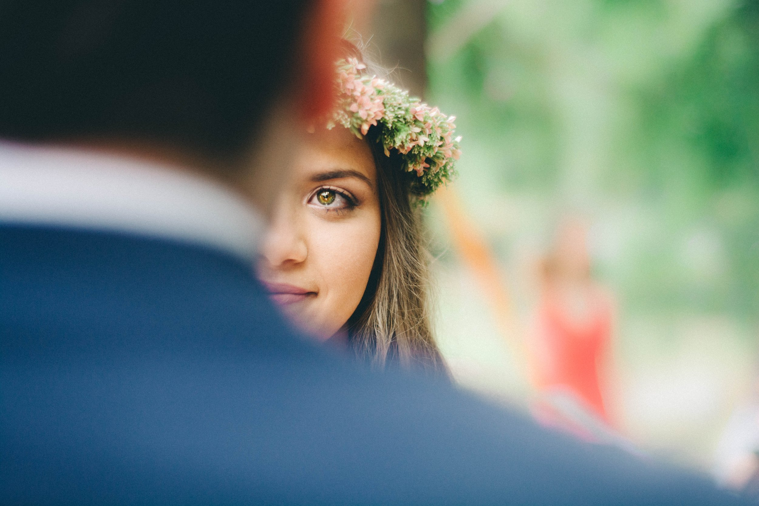 Bride with flower crown looking at her groom
