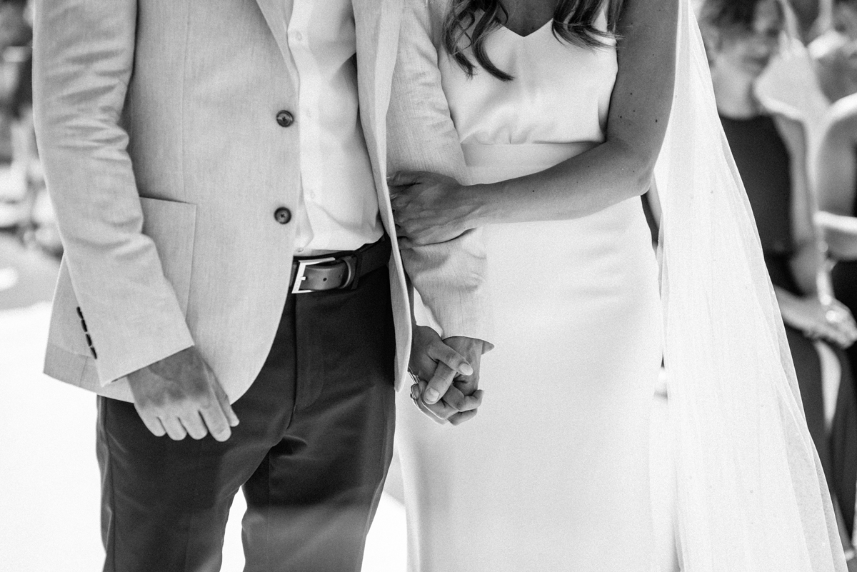 Wedding couple holding hands during ceremony at La Escollera Ibiza