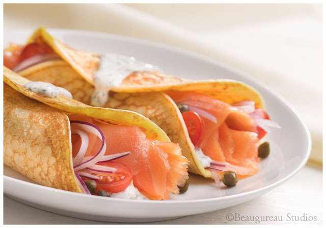 Ricotta cheese provides an unexpected tenderness to smoked Salmon-filled Crepes.