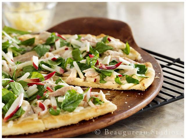 A unique White BBQ sauce accents this wonderful pizza.