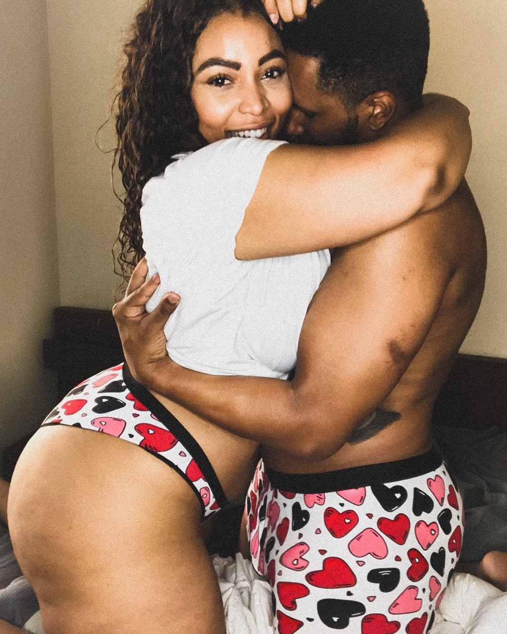 Candice Kelly and her Boyfriend snuggling in their MeUndies Matching Valentine's Day Set