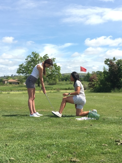 My friend MiKaela got her first lesson by Theresa after only swinging a golf club at Topgolf twice!