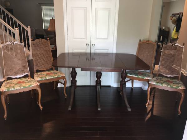Table and 4 Cane Chairs - $80