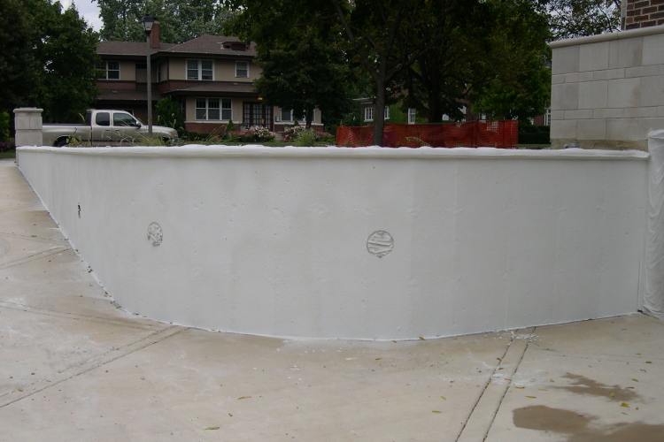 Concrete Driveway Retaining Wall With White Cement Overlay Base Coat