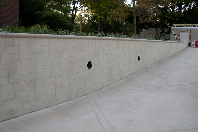 Newly Installed, Patterned Cement Overlay of Existing Concrete Driveway Retaining Wall
