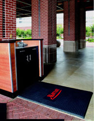 This customized mat is ideally positioned to protect the acid-stained concrete outside this Marriott hotel. Photo courtesy of: KBA Marketing, Inc. of Vero Beach, FL.
