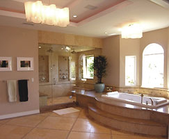 This elegant bathroom has a natural stone tile floor which can be perfectly imitated and re-produced by using acid staining coloring on concrete, and dust-free saw-cutting or concrete stenciling.