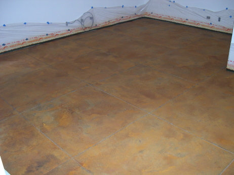 Acid Staining Of Finished Basement Concrete Floor After Saw-Cutting Large, Spanish Tile Design Pattern