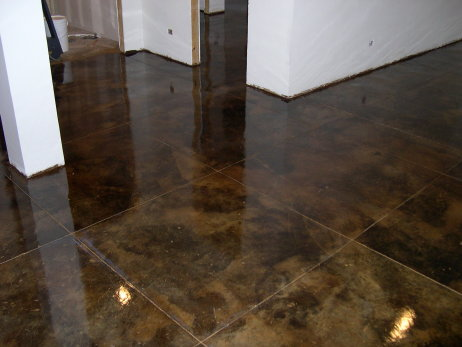 Dark Brown, Acid-Stained Finished Basement Concrete Floor With Saw-Cut Tile Design Pattern and Clear Epoxy Sealer
