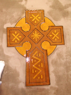 Celtic Cross Design Engraved In Self-Leveling Cement Overlay And Acid-Stained