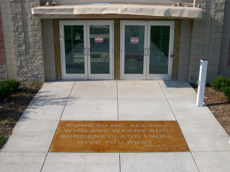 Acid-Stained Concrete Church Entryway with Bible Verse Engraving