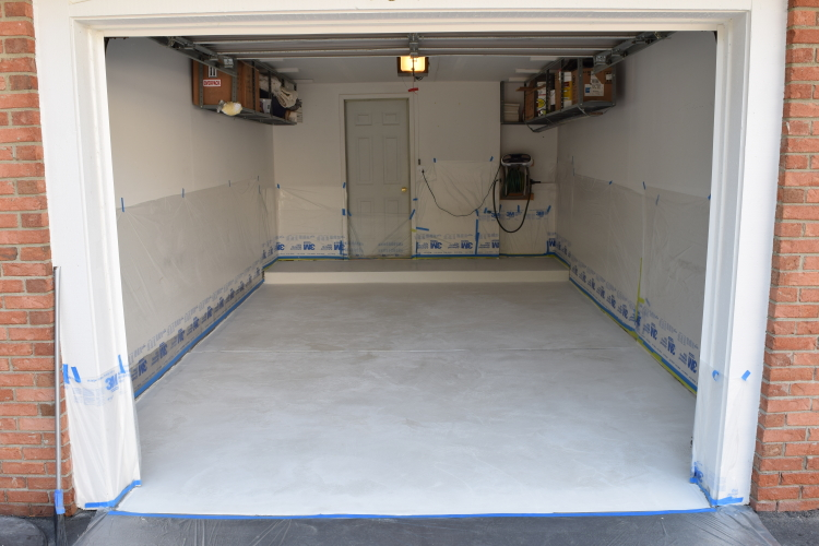 Dirty Garage Concrete Floor After Installing White Cement Overlay