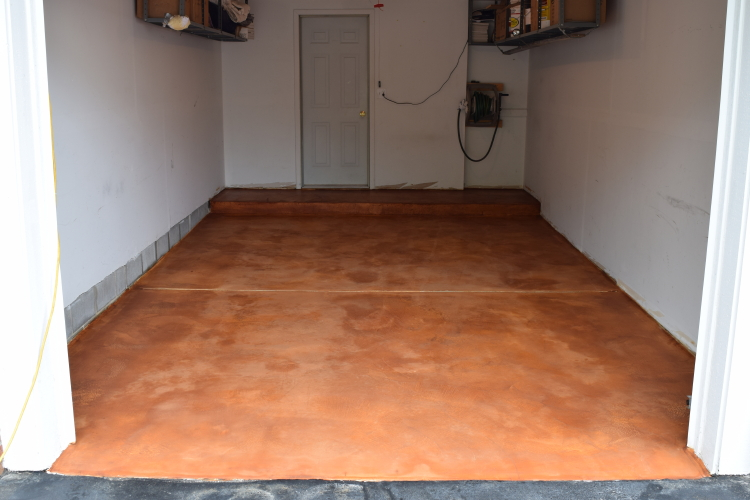 Acid-Stained, White Cement Overlay Of Garage Concrete Floor After Rinsing Excess Residue