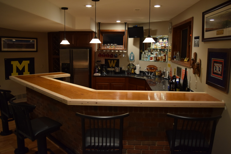 Existing Wood Bar Countertop In Finished Basement Modified In Preparation For Decorative Cement Overlay