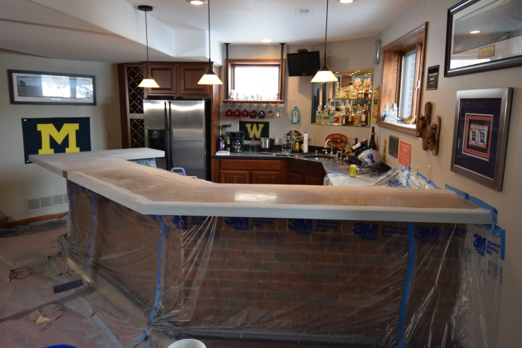 Wood Bar Countertop In Finished Basement After Surface Preparation For Decorative Cement Overlay